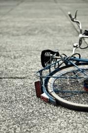 Cycliste heurté par la portière de l'auto