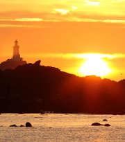 soleil-couchant-mer-phare